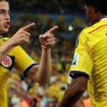 Colombia's James Rodriguez (10) celebrates with his teammate Juan Cuadrado (11) after he scored his side's second goal during the World Cup round of 16 soccer match between Colombia and Uruguay at the Maracana Stadium in Rio de Janeiro, Brazil, Saturday, June 28, 2014. (AP Photo/Marcio Jose Sanchez)
